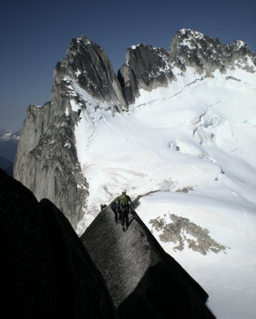 Descending the West Ridge of Pigeon Spire with the Howser Towers in the background