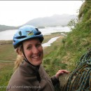 Rebecca at the first belay of Fisher's Folly with a rapid deteriorating view of Skidaw behind