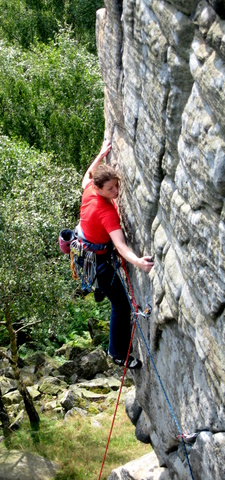 Petra makes the long reach on Chequers Buttress