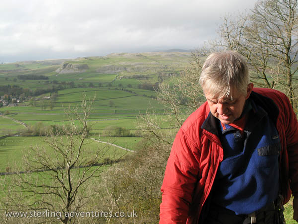 Paul getting ready with Robin Proctor's Scar behind and across the valley from Austwick