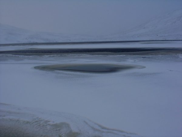 The lake - an interesting mix of frozen and open water.