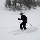 Rachel shows her style in the powder on the first run of the day.