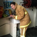 Laetitia signs a Cumbria Fire Service indemnity