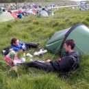 Tom and I enjoy dinner and sunshine at the mid-camp. Lying down was probably a necessity at this point!