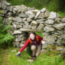 Laetitia tunnelling through a dry-stone wall!