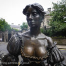 """In Dublin's fair city, Where the girls are so pretty, I first set my eyes on sweet Molly Malone"""
