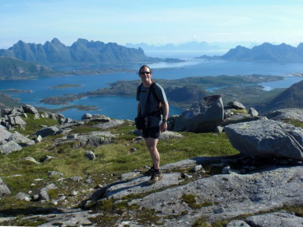 Rachel near the summit of Rundfjellet, with the view of Austnesfjorden behind.