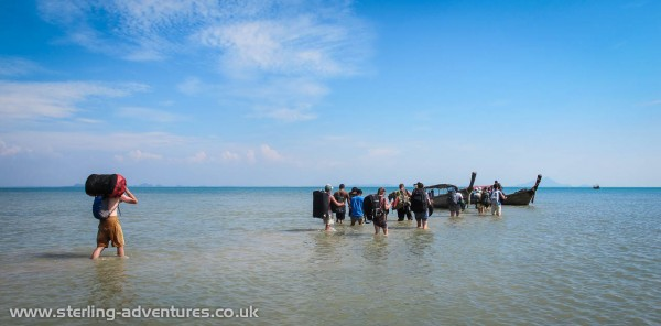 Wading out to the longtail boats that took us away from Railay.
