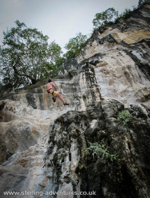 Pete sweating buckets on a tough mildly overhanging 6c+ at Dum's Kitchen.