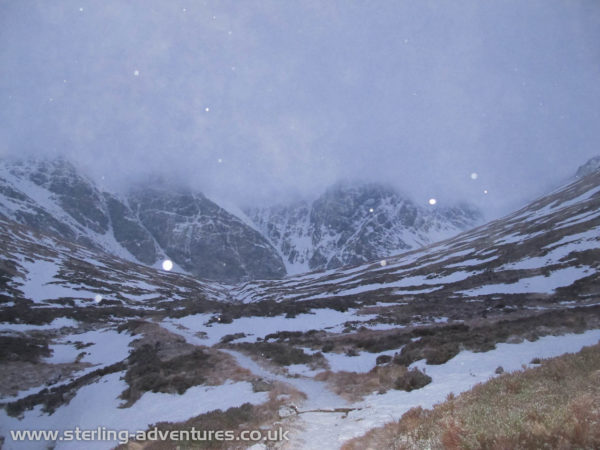 Creag Meagaidh emerges from in the dawn as we approach up Coire Ardair