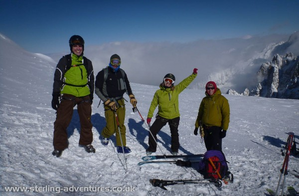 At the bottom of the arete the team get ready to ski the Valleé Blanche