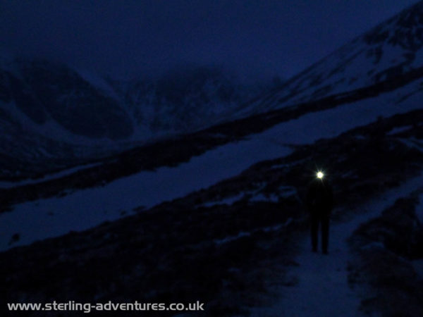 Laetitia's head torch on the long easy approach up Coire Ardair