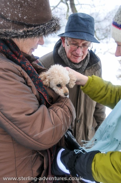 Pauline, Bob, and Saskia try to keep a very small poodle warm in Derby's siberian Darley Abbey (sledging) Park