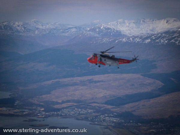 A rescue helicopter above the tourist track up Ben Nevis evacuating an injured walker.