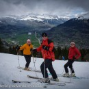 Ian, Chris, and Laetitia pose on the piste at Les Houches with the spring-time green of the Sallanches valley far below.