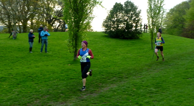 Anna in high viz gloves ( in case she needs to wave in the dark) in the finishing straight