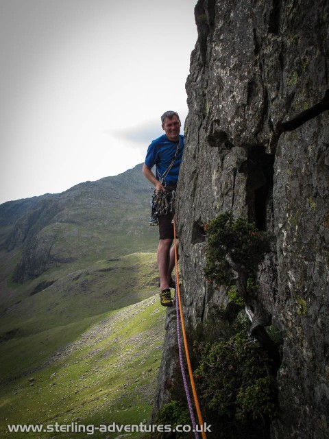 Pete on the start of the not too often climbed easy second pitch of Red Edge