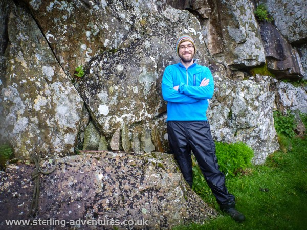 "Chris poses next to the ""Vlad  Stones"" at Dove Crag"