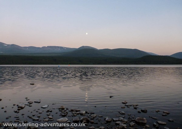 The moon reflected in Loch Morlich, and if you look carefully you can see the clouds of midges coming straight at the photographer -