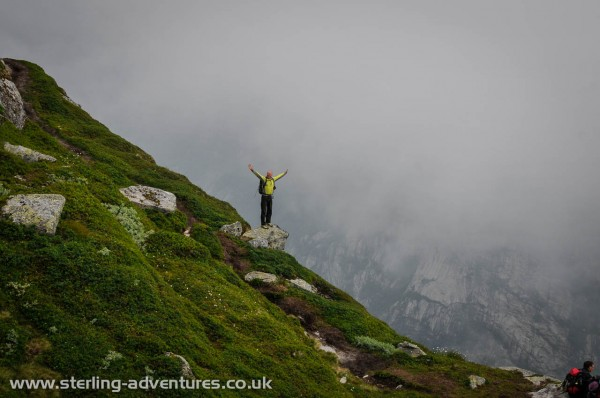 Richard celebrates a break in the cloud above the massive 984m drop in to Lysefjorden