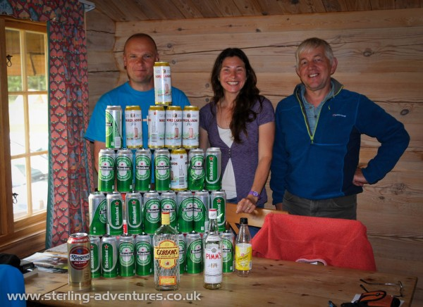 Richard, Laetitia, and Paul pose in front of a week's heavy (by Norwegian standards) drinking!