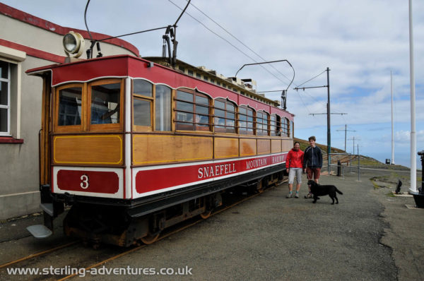 Laetitia and Laurence pose next to the Snaefell Mountain Railway tram