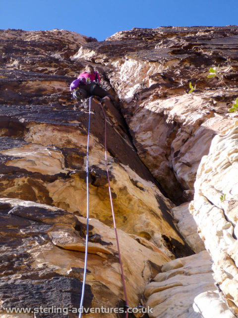 Laetitia leading the vertical first pitch of Geronimo - thankfully although it's vertical the holds are massive!Geronimo only gets one star in the guidebook - it deserves at least two - it's brilliant climbing!