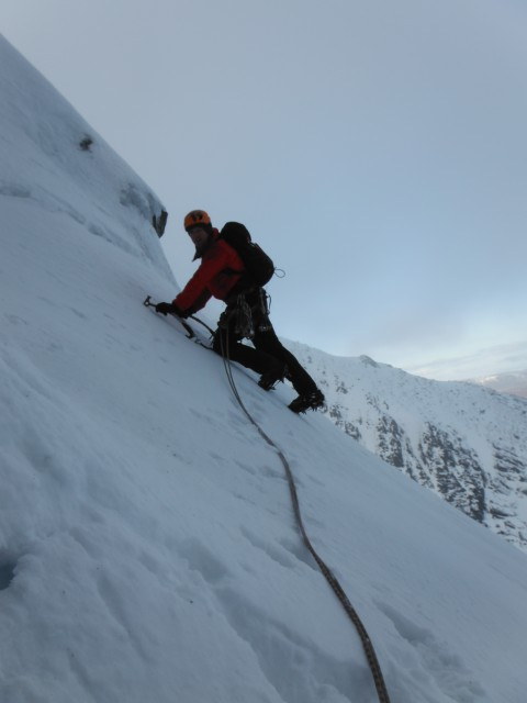 Climbing up easy ground on the second pitch