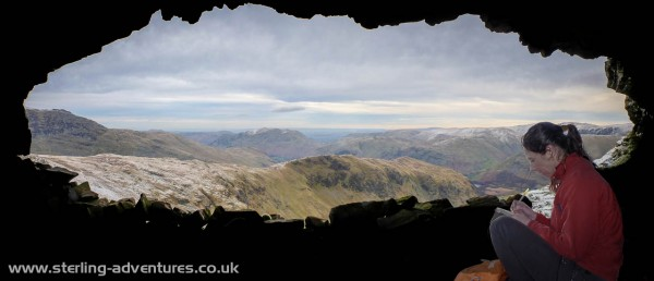 The view from the Priest's Hole on Dove Crag with Laetitia signing the visitor's book