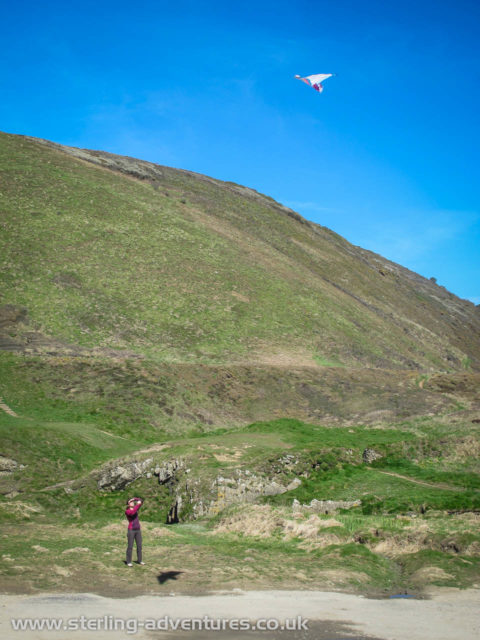 Laetitia flying our rescued kite at Welcombe Mouth