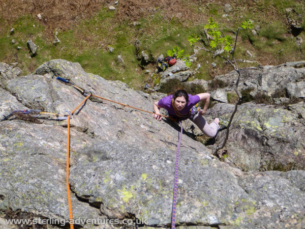 Laetitia following the surprisingly brilliant upper wall of Rowan Tree Groove