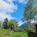 Pete walking through the meadow on the way towards Dalle a Bournet at Secteur Vallon de Van.