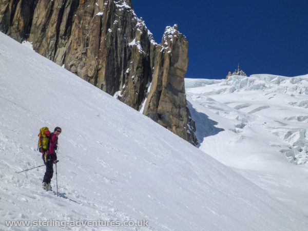 Laetitia heading towards to Géant Glacier with the Aiguille du Midi in the background.